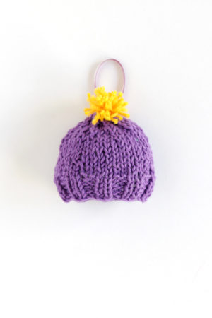 Get your hands on this adorable pattern for a knit stocking cap ornament! Click through for the FREE pattern.