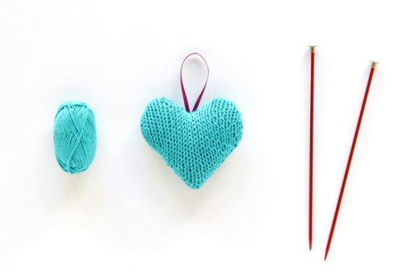 Knit Heart Ornament - Click through for a free knitting pattern for this cute star ornament, which also makes a great tree star, gift topper or baby toy!