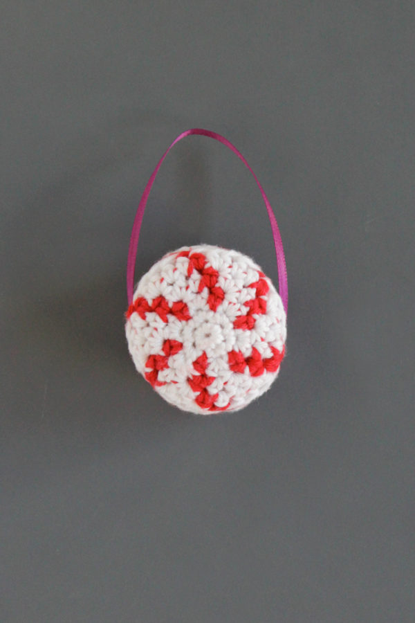 A free crochet pattern for a quick and festive peppermint ornament. Click through for the free pattern!