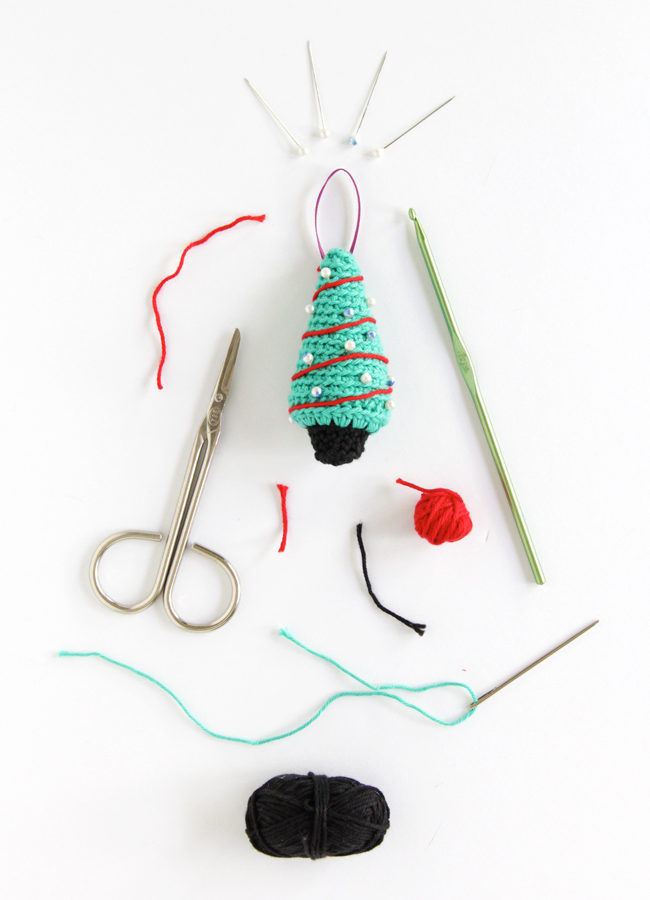 A pattern for a crochet Christmas tree ornament that works up super quick! Click through for the free pattern.