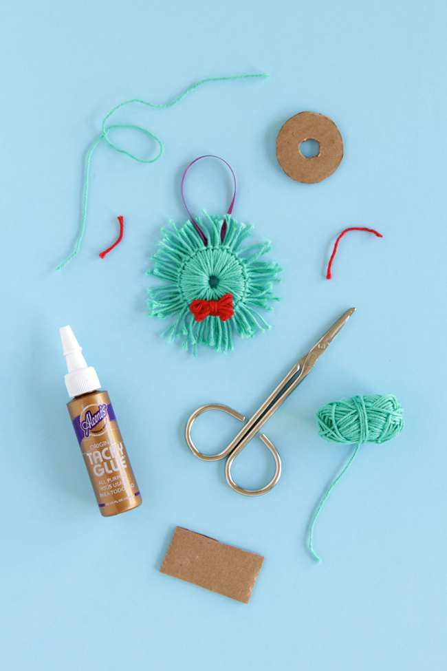 Instructions for how to make two ornaments with yarn scraps: an adorable angel and a holiday wreath! Click for the tutorials.