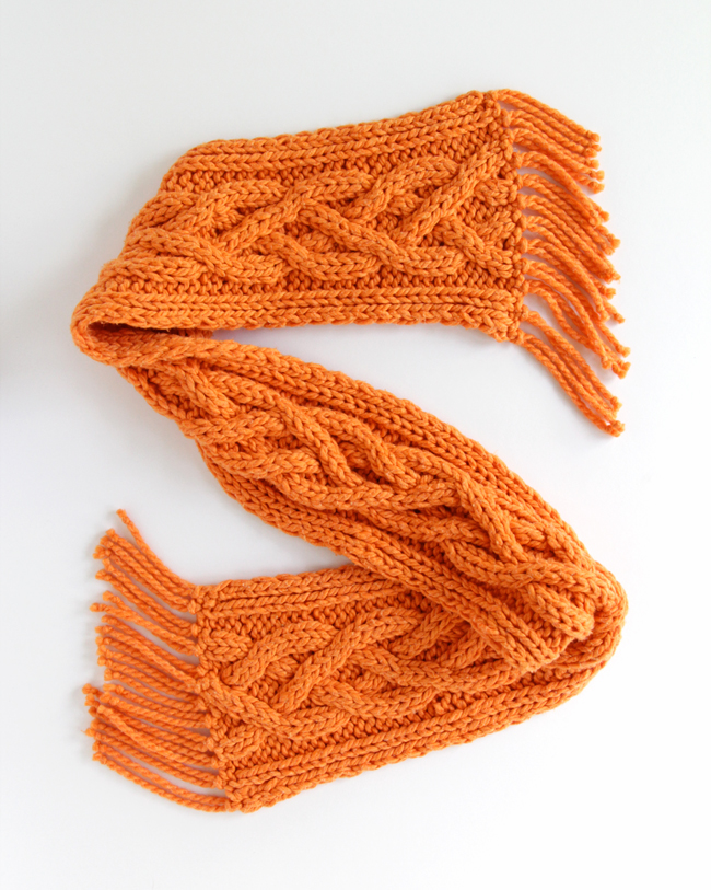 Click through to get a free pattern for the Quad Cable Scarf by Heidi Gustad