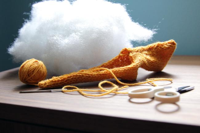Knit lightning bolt in progress - before stuffing. Visit handsoccupied.com for the free pattern!