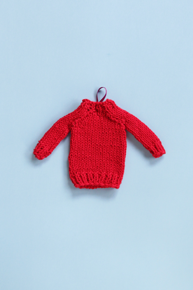 Get a free pattern for this mini knit sweater, which works great for doll clothes, holiday ornaments or as a gift topper!