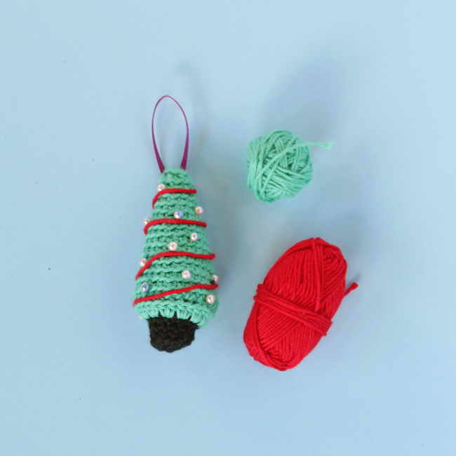 Crochet the cutest little Christmas tree you ever saw with this free amigurumi ornament pattern.