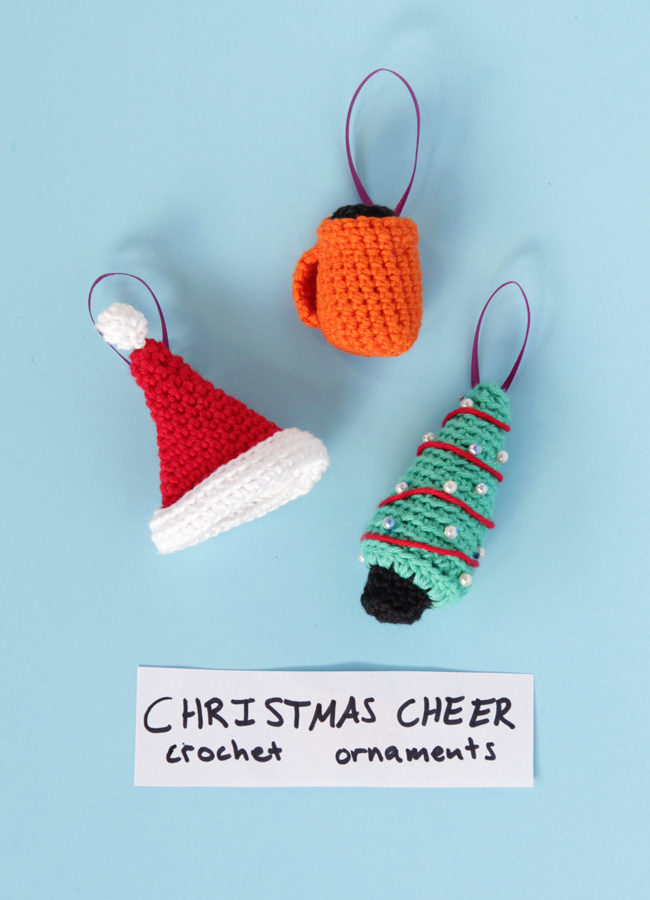 Christmas comes just once a year - celebrate with cute crochet ornaments! Click through for three free amigurumi patterns for a jaunty Santa hat, cheery mug & a sweet mini Christmas tree ornament!