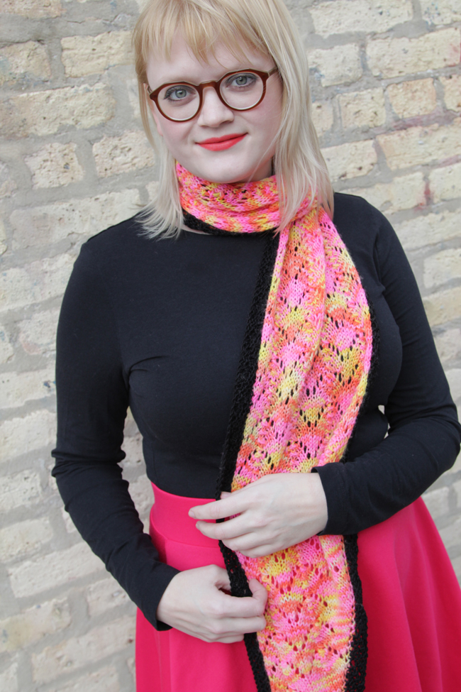 Knit Designer Heidi Gustad modeling the Rhombuster Scarf pattern, available on Ravelry.