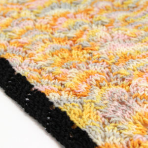 Learn how to pick up stitches in knitting. This easy video tutorial shows you how to pick up and knit stitches in a selvage edge.