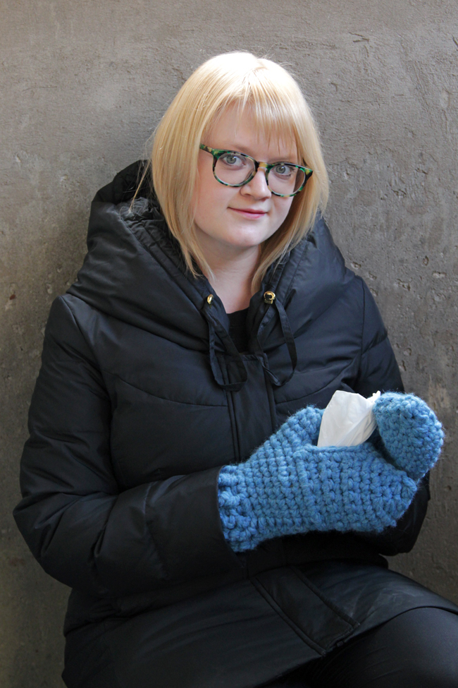 Crochet Designer Heidi Gustad modeling the Kleenex Share Mitts, available on handsoccupied.com.