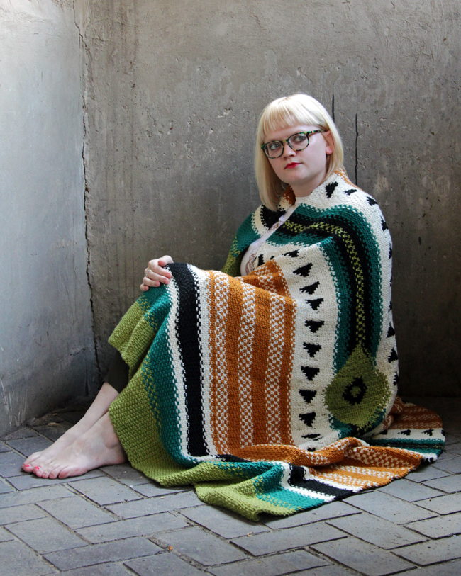 The Arizona Afghan is a single panel blanket inspired by iconic woven blankets of the American Southwest. The bold, graphic design of this throw is accomplished through a combination of linen stitch, stranded colorwork, slipped stitches and a dash of intarsia. Get the pattern in I Like Knitting magazine.