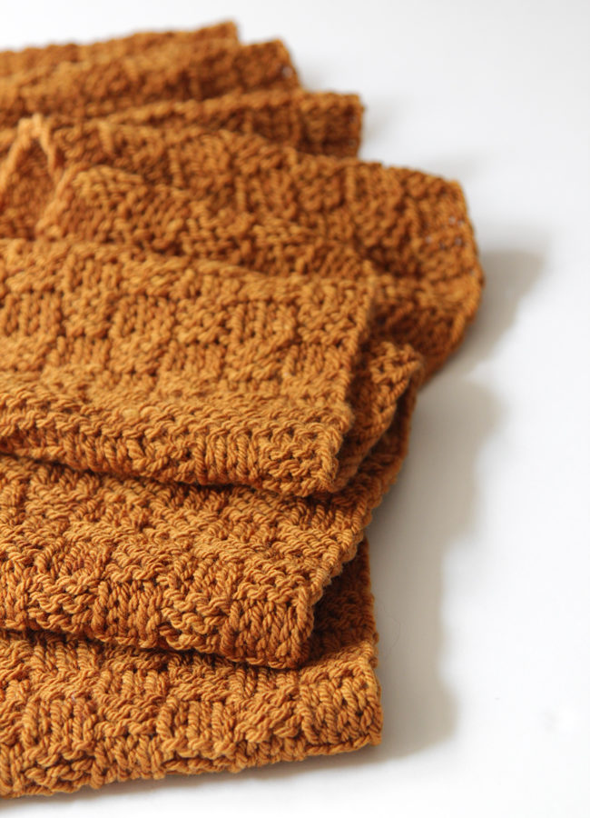 Get your hands on a free knitting pattern for the Golden Check Infinity Scarf!