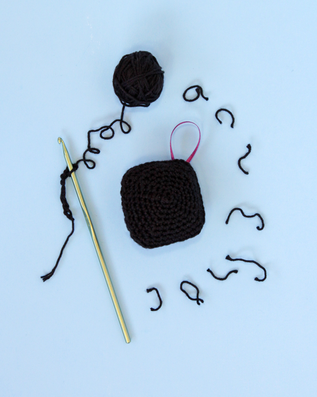 Have a little fun with your handmade gifts this holiday! Crochet an amigurumi coal ornament for your Christmas tree or as a funny stocking stuffer with this free pattern.