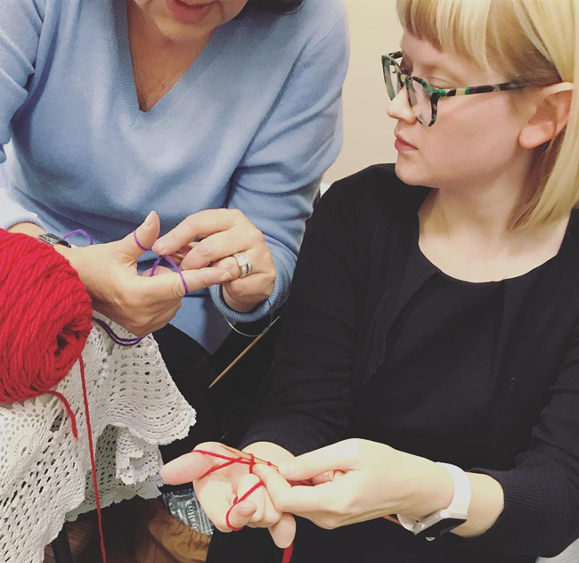 Knit & Crochet Designer Heidi Gustad teaching a knitting workshop.