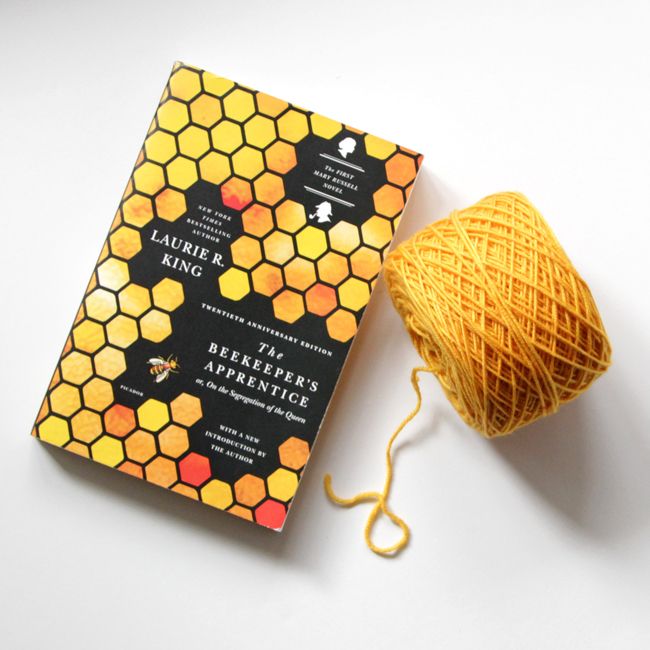 The Beekeeper's Apprentice by Laurie R. King and a skein of Why Knot Fibers' Spunky yarn in Magic for Marigold