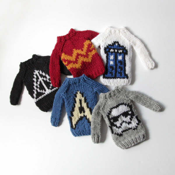 The Mini Fandom Sweaters Collection by Heidi Gustad, designed as part of Fandom Fiibers' inaugural collection and available exclusively in kits at C2E2 2018. Available as PDFs beginning April 9.