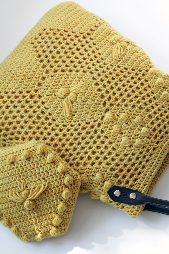 Crochet the Worker Bee Bag & Worker Bee Clutch during the Read Along Crochet Along, April 1-30! This adorable bag uses filet crochet, baubles, and elongated stitches to create a fun, textural piece perfect for spring!