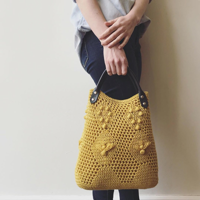 Crochet the Worker Bee Bag & Worker Bee Clutch! This adorable bag uses filet crochet, baubles, and elongated stitches to create a fun, textural piece perfect for spring!