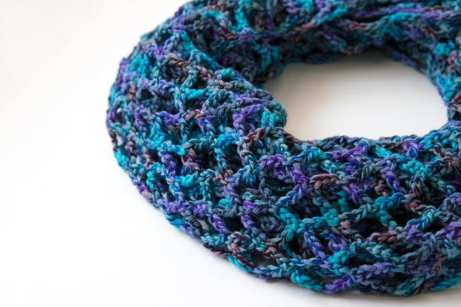 Crochet the versatile Market Cowl, a free pattern that does double duty as a layering-friendly cowl or wrap.