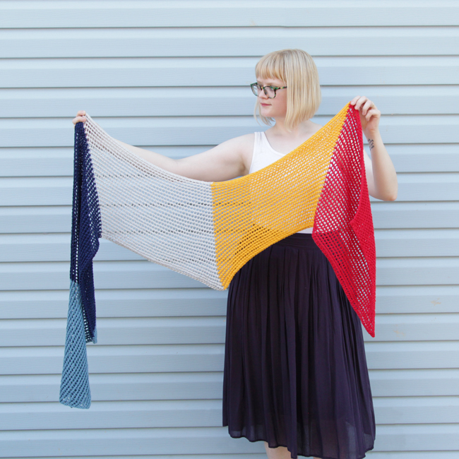 Who doesn't love an easy-to-knit, versatile pattern? The Wherever Wrap is a fun colorblock piece knit with a simple lace motif. Get the free knitting pattern by designer Heidi Gustad.