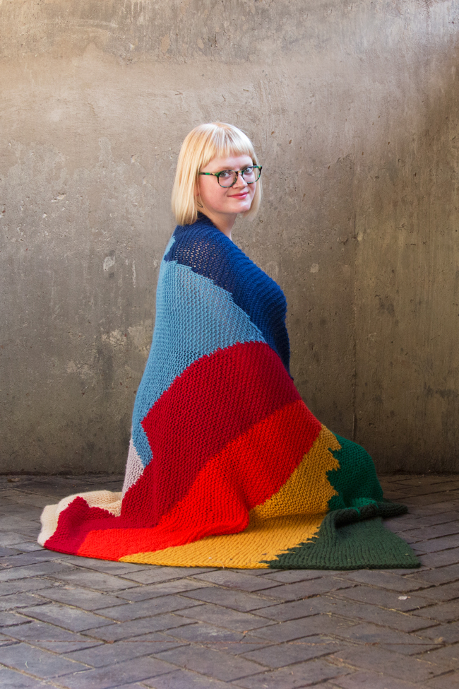 Heidi Gustad modeling the Intarsia Mountain afghan