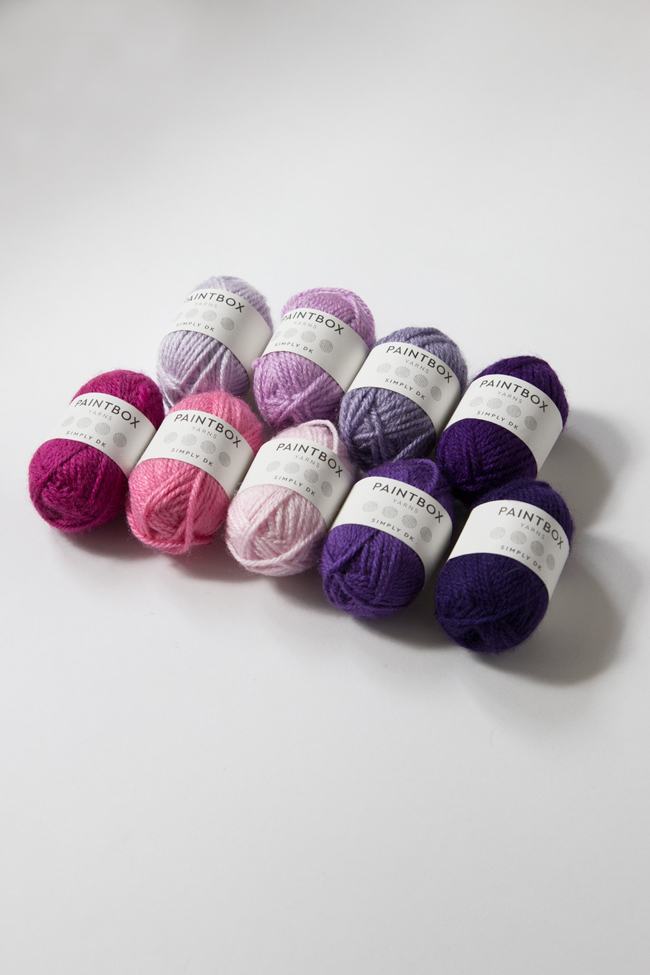 Mini skeins are a great way to put together sample color palettes for knitting and crochet projects. Get inspired with five color palettes for the 9-color Intarsia Mountain afghan pattern, curated by its designer, Heidi Gustad.