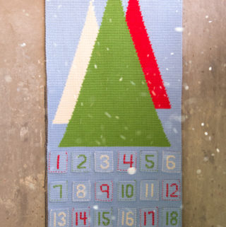 Scandinavian Advent Calendar - free crochet pattern -- An advent calendar is a great way to make your own keepsake Christmas decoration and build a family tradition for years to come. The Scandinavian Advent Calendar is great for crocheters at almost any skill level and is inspired by beautiful holiday decor found in Scandinavia. This pattern features basic embroidery stitches for added texture and a handmade look.