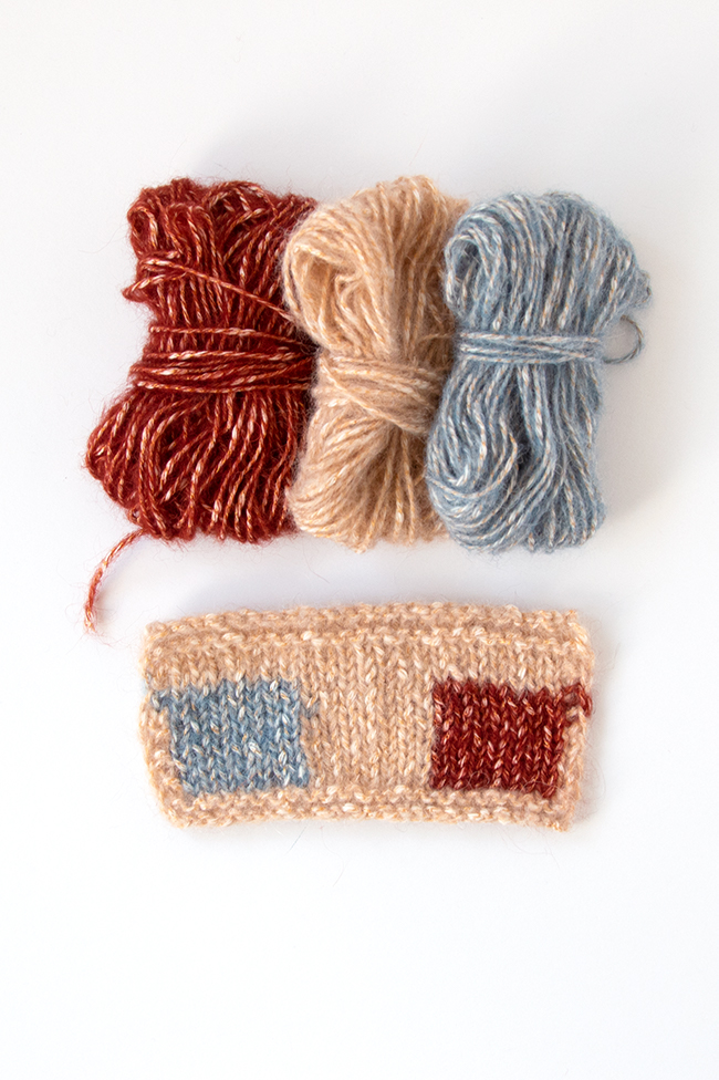 Berroco Brielle yarn in Blond, Bleu & Rouille. Click through to win a kit featuring this yarn and the Checked Snood knitting pattern by Heidi Gustad.