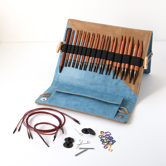 Knitter's Pride's Ginger Interchangeable Circular Needle sets combine beautiful wood and quality accessories into a thoughtful, practical case. Each set contains 13 pairs of needles, a matching pen, a chart holder, 6 sets of cords, and more. Get a closer look with this review from Hands Occupied.