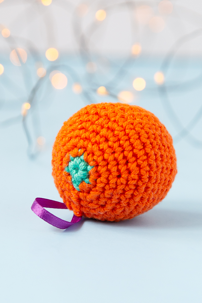 The gift of citrus fruit, particularly oranges, is a long-standing Christmas treat. To celebrate this old-fashioned holiday tradition, crochet a fast orange ornament for your tree! Get the free pattern on Hands Occupied.