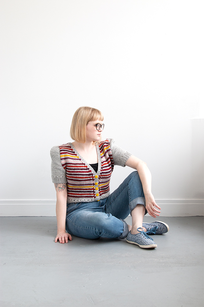 Knittable in two weekends (really!), a short sleeved, worsted weight cardigan is a quick addition to a handmade wardrobe. Check out Heidi's modified take on the Myrna cardigan using Blue Sky Fibers' Woolstok yarn.