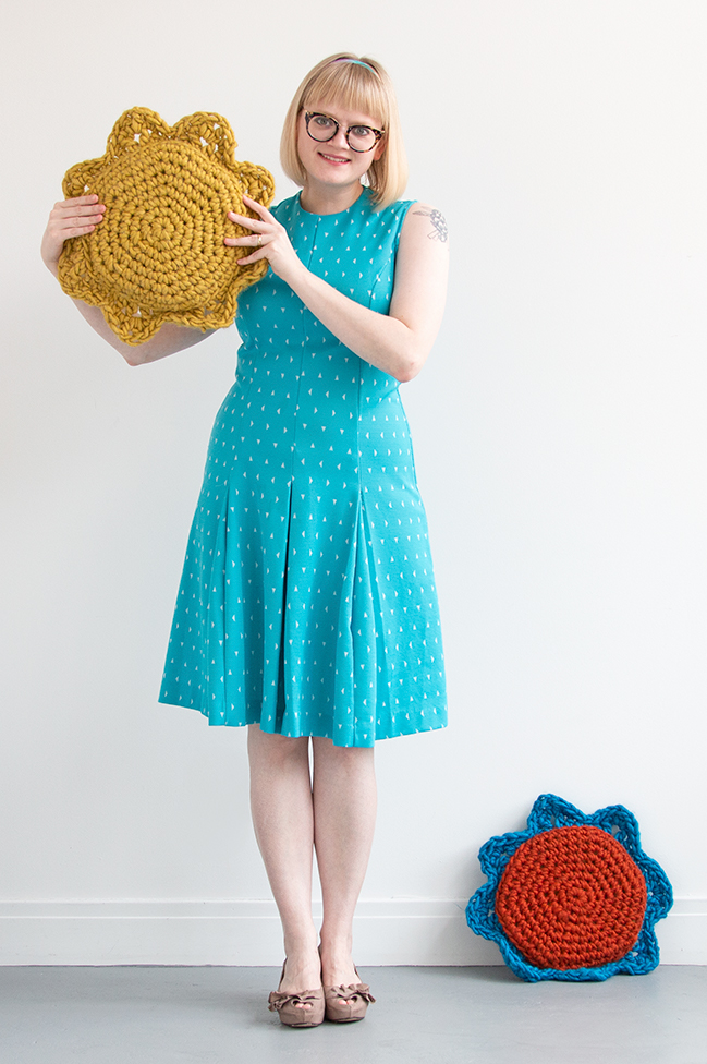 Sun & Flower Pillows - free crochet pattern! Quickly crochet a set of adorable, summery home accessories with the free pattern for these sun and flower-inspired throw pillows! Visit the Hands Occupied blog for the free crochet pattern. #crochet #freepattern #bulkyyarn #quickcrochetproject