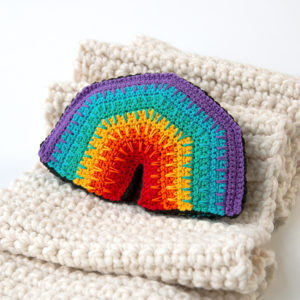 Over the Rainbow Softie, a free crochet pattern using 1 package of Lion Brand Bon Bons yarn. Crochet an adorable, on-trend softie toy that easily doubles as DIY nursery decor.