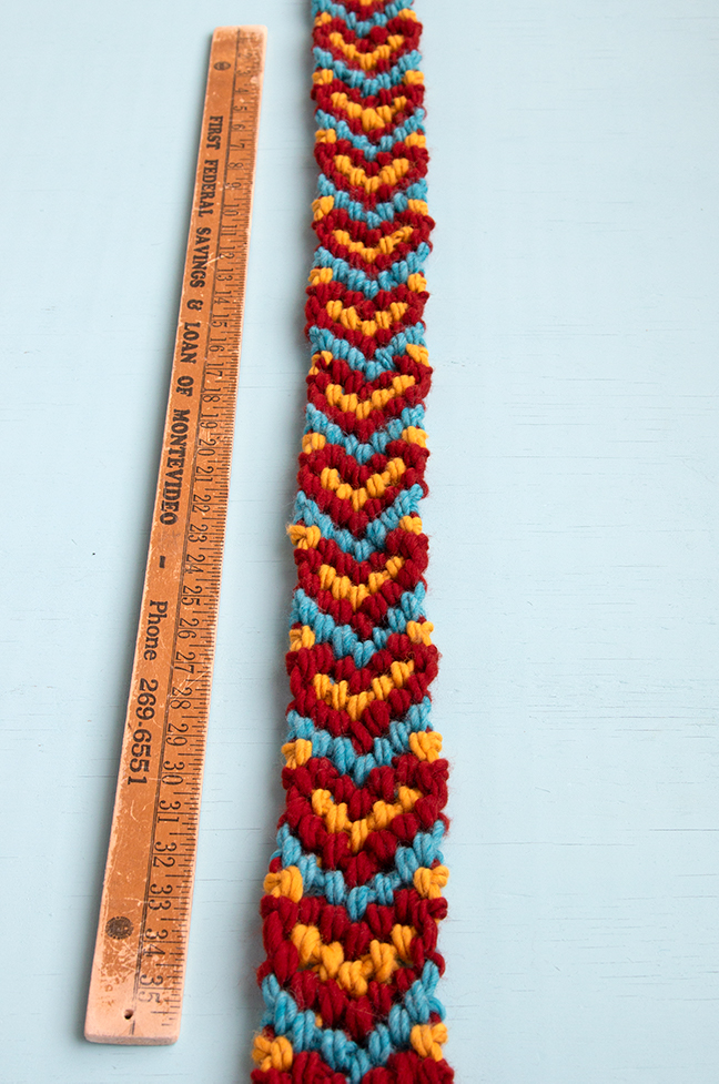 Make a giant friendship bracelet-inspired runner for your Friendsgiving table! Knotted with 100% American wool, this easy project doubles as a hostess gift and macramé scarf. Visit handsoccupied.com to learn how to make this easy Thanksgiving craft project.