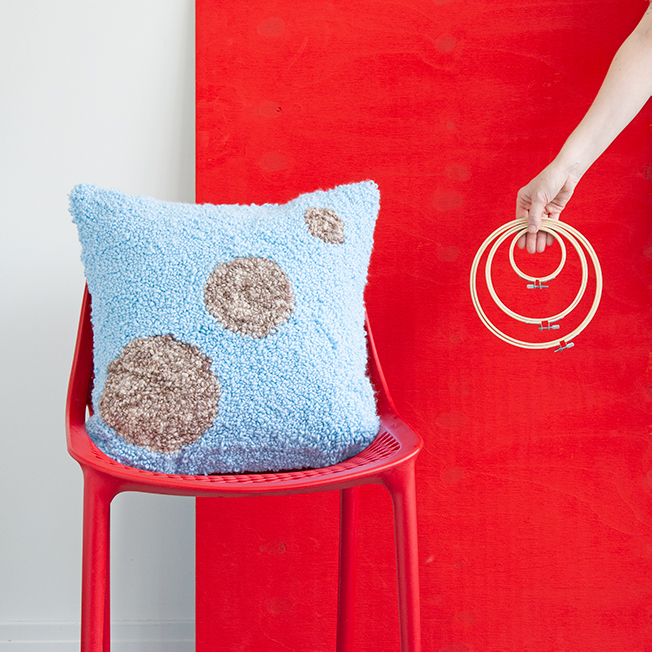 Learn how to make these planet-inspired punch needle throw pillows using embroidery hoops!