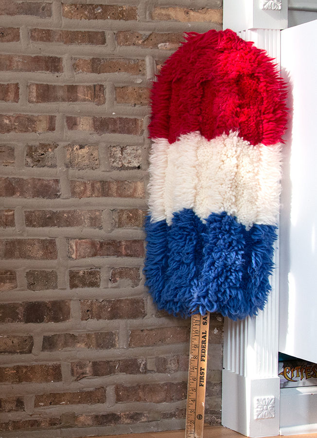 Learn how to make this bomb popsicle-inspired latch hook wall hanging with a free pattern and tutorial from Hands Occupied.