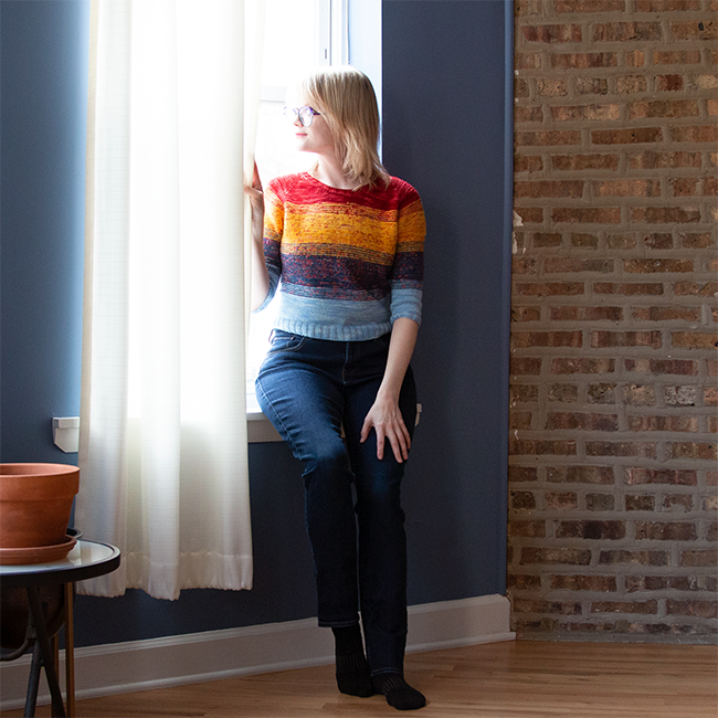 Heidi from Hands Occupied wearing her primary colored version of the So Faded sweater by Andrea Mowry.