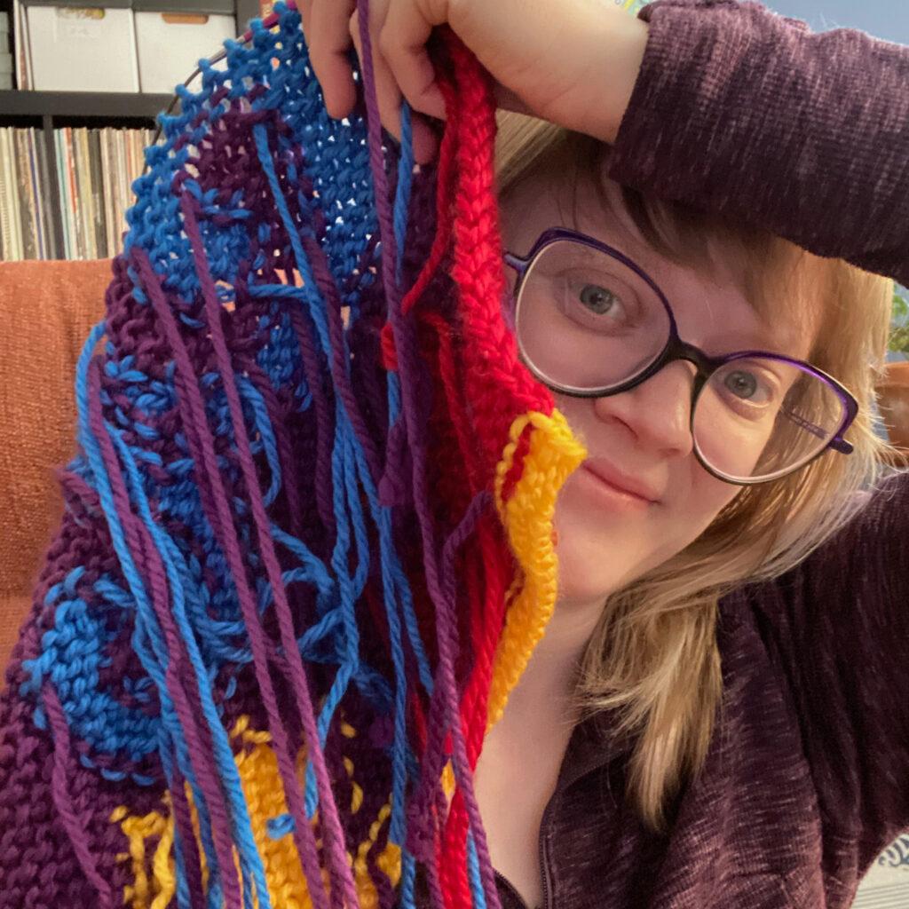 Heidi with a big intarsia knitting swatch.