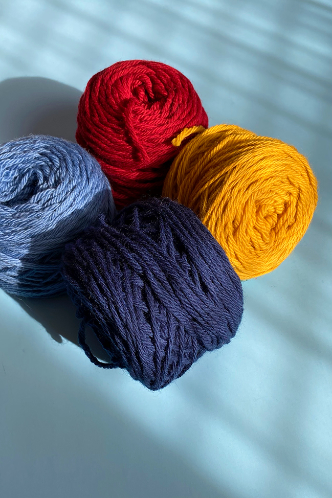 Four skeins of primary colored yarn used to help explain the concept of color value.
