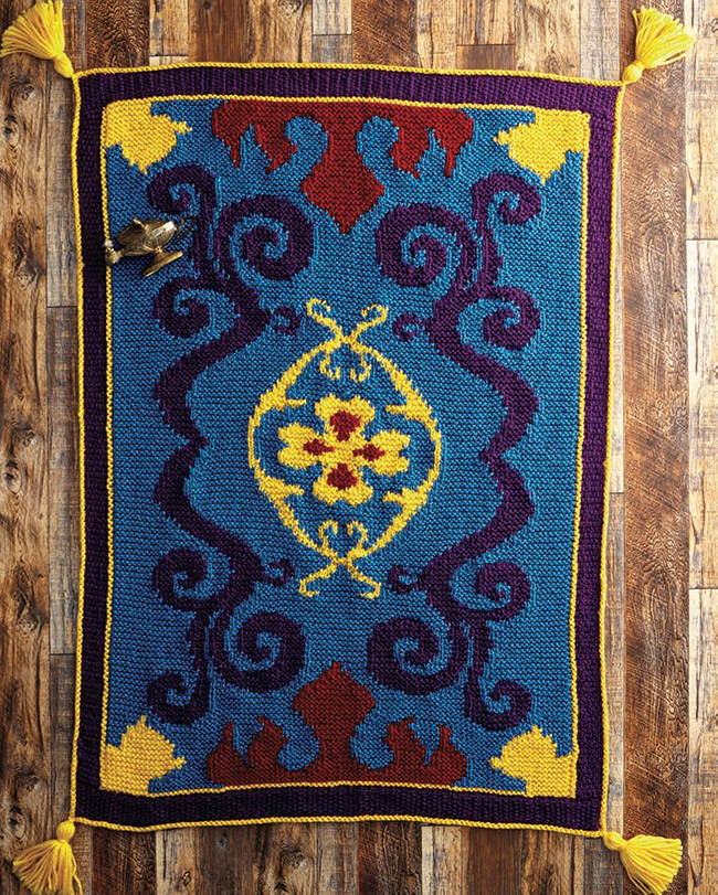 The Magic Carpet Throw Blanket by Heidi Gustad can be found in the new Knitting with Disney book by Tanis Gray! (Insight editions, 2021)